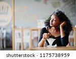 african american girl sitting... | Shutterstock . vector #1175738959