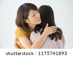 a crying woman and woman to... | Shutterstock . vector #1175741893