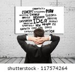 businessman sitting and poster  business tags - stock photo