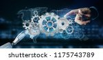 view of a cyborg hand holding a ...   Shutterstock . vector #1175743789