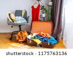 overloaded valise with clothes. ... | Shutterstock . vector #1175763136