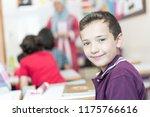 happy arabic student at school    Shutterstock . vector #1175766616