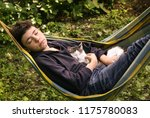 teenager boy with cat sleep in... | Shutterstock . vector #1175780083