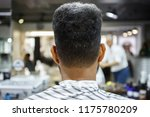 young black man in barbershop... | Shutterstock . vector #1175780209