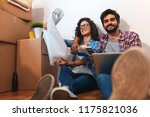happy young couple moving into... | Shutterstock . vector #1175821036