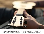 playing a small guitar ukulele | Shutterstock . vector #1175826460