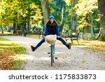 urban biking   woman riding... | Shutterstock . vector #1175833873