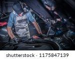 car mechanic work. caucasian... | Shutterstock . vector #1175847139