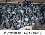 sculptures of hands in the... | Shutterstock . vector #1175850343