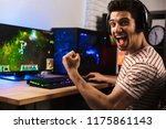 portrait of ecstatic gamer guy... | Shutterstock . vector #1175861143