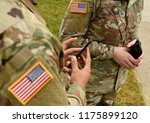 us soldiers use smartphones | Shutterstock . vector #1175899120