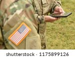 us soldier use smartphone | Shutterstock . vector #1175899126