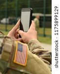 us soldier use smartphone | Shutterstock . vector #1175899129