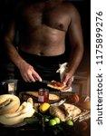 strong man cooking breakfast | Shutterstock . vector #1175899276