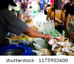coconut ice cream from street... | Shutterstock . vector #1175902600