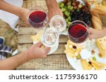 friends holding glasses of wine ... | Shutterstock . vector #1175936170