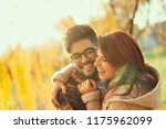 young couple in love hugging ... | Shutterstock . vector #1175962099