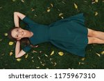 carefree pretty woman lies on a ...   Shutterstock . vector #1175967310