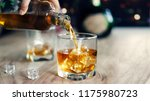 man pouring whiskey in glasses...   Shutterstock . vector #1175980723