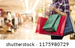 black friday  woman holding... | Shutterstock . vector #1175980729