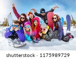 happy friends skiers and... | Shutterstock . vector #1175989729