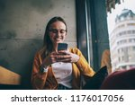 cheerful hipster girl in... | Shutterstock . vector #1176017056
