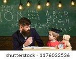 father teaches son  discuss ... | Shutterstock . vector #1176032536