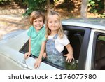 cute little children in car | Shutterstock . vector #1176077980