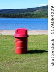 red garbage can at park with... | Shutterstock . vector #1176084229