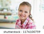 portrait of cute smiling girl... | Shutterstock . vector #1176100759