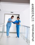 nurse and doctor discussing... | Shutterstock . vector #1176100849