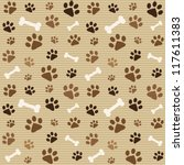 Stock vector seamless pattern with brown footprints and bones 117611383