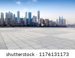 empty ground and buildings in... | Shutterstock . vector #1176131173