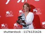 natalya kudryashova poses with... | Shutterstock . vector #1176131626