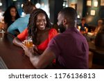 couple on date sitting at bar... | Shutterstock . vector #1176136813