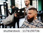 handsome bearded man at the... | Shutterstock . vector #1176150736