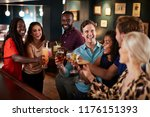 group of friends standing at... | Shutterstock . vector #1176151393