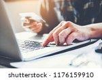 man's hands typing laptop... | Shutterstock . vector #1176159910