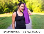 tired sport asian woman with... | Shutterstock . vector #1176160279