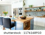 stylish and sunny kitchen... | Shutterstock . vector #1176168910