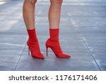 woman wearing red sock ankle... | Shutterstock . vector #1176171406