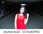 beautiful young girl in a red... | Shutterstock . vector #1176182953