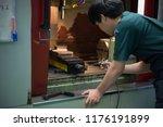 mechanical engineer working at... | Shutterstock . vector #1176191899