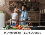 happy romantic couple dancing... | Shutterstock . vector #1176204889
