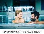 happy attractive couple... | Shutterstock . vector #1176215020