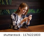 beautiful girl with a phone in...   Shutterstock . vector #1176221833