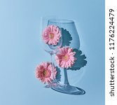 glass of wine with pink... | Shutterstock . vector #1176224479