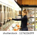 woman choosing frozen food from ... | Shutterstock . vector #1176226399