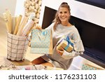 adult woman at home wrapping... | Shutterstock . vector #1176231103