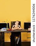 girl sits at her desk with... | Shutterstock . vector #1176244006